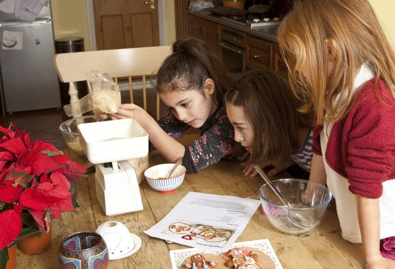 Young kids doing a recipe from book