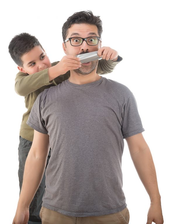 Boy silencing teacher with duct tape
